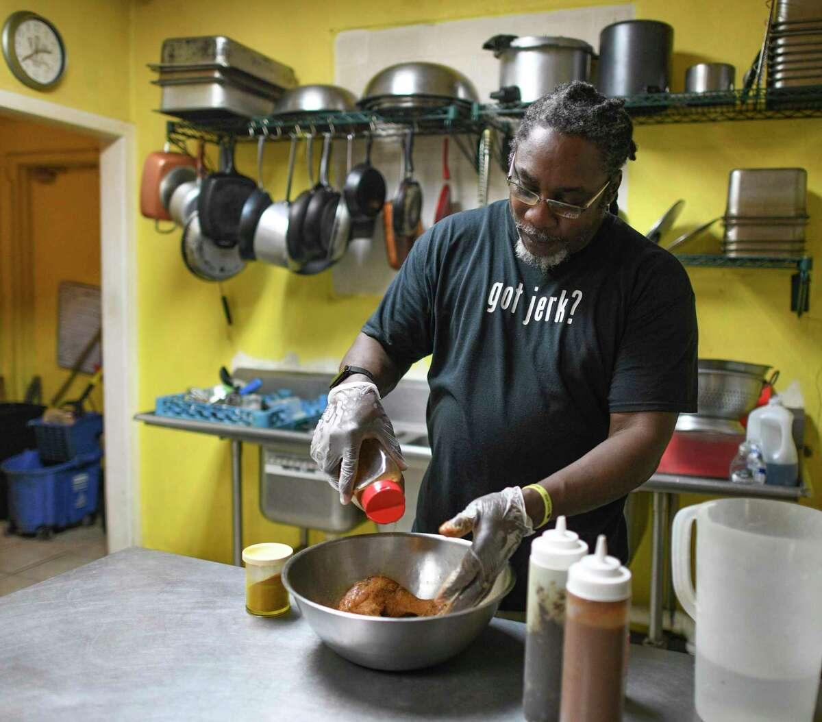 Angello Gordon prepares jerk chicken at Jamaica Jamaica Cuisine, which has served San Antonio since 2011.