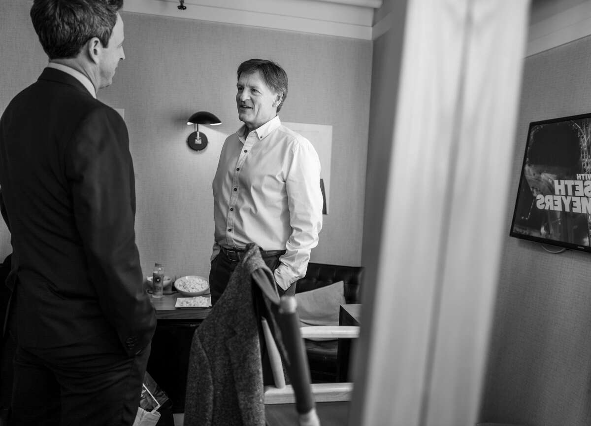 Seth Meyers talks with author Michael Lewis in 2019.