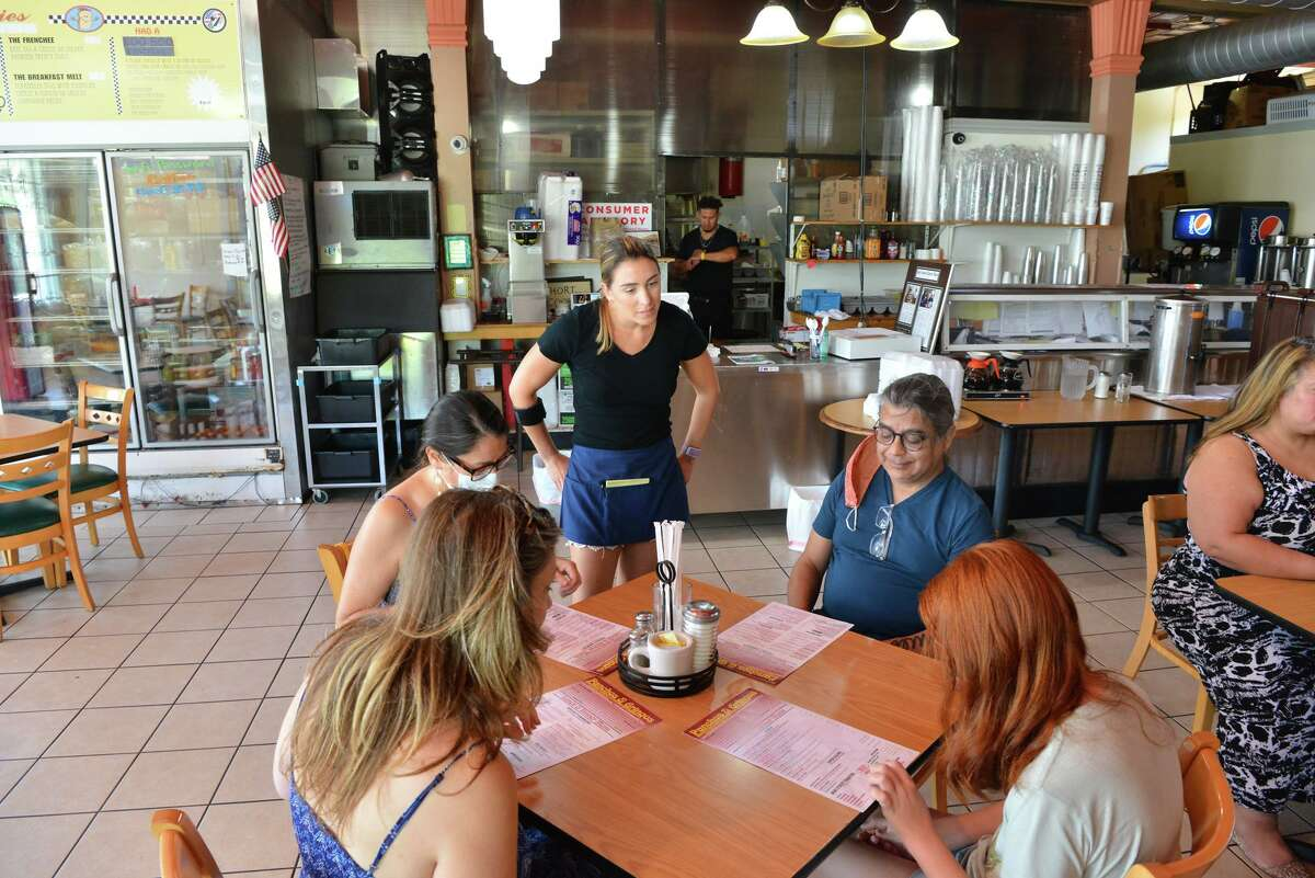 Volunteer and customer Alyson Fitzpatrick takes orders from customers at Panchos and Gringos restaurant.