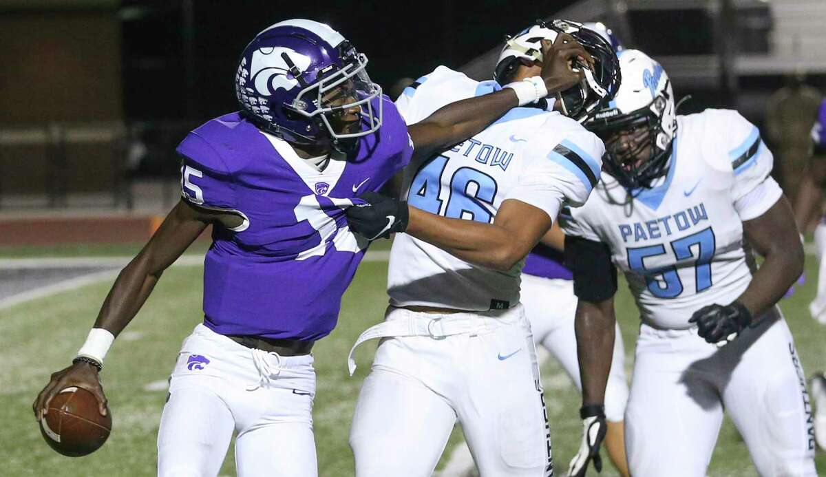 Angleton Wildcats quarterback Jordan Pickett (15) face mask Paetow Panther linebacker Alex Kilgore (46) as Kilgore sacks Pickett for a loss of yards in the second quarter in a high school football game on November 20, 2020 at Angleton Wildcat Stadium in Angleton, TX.