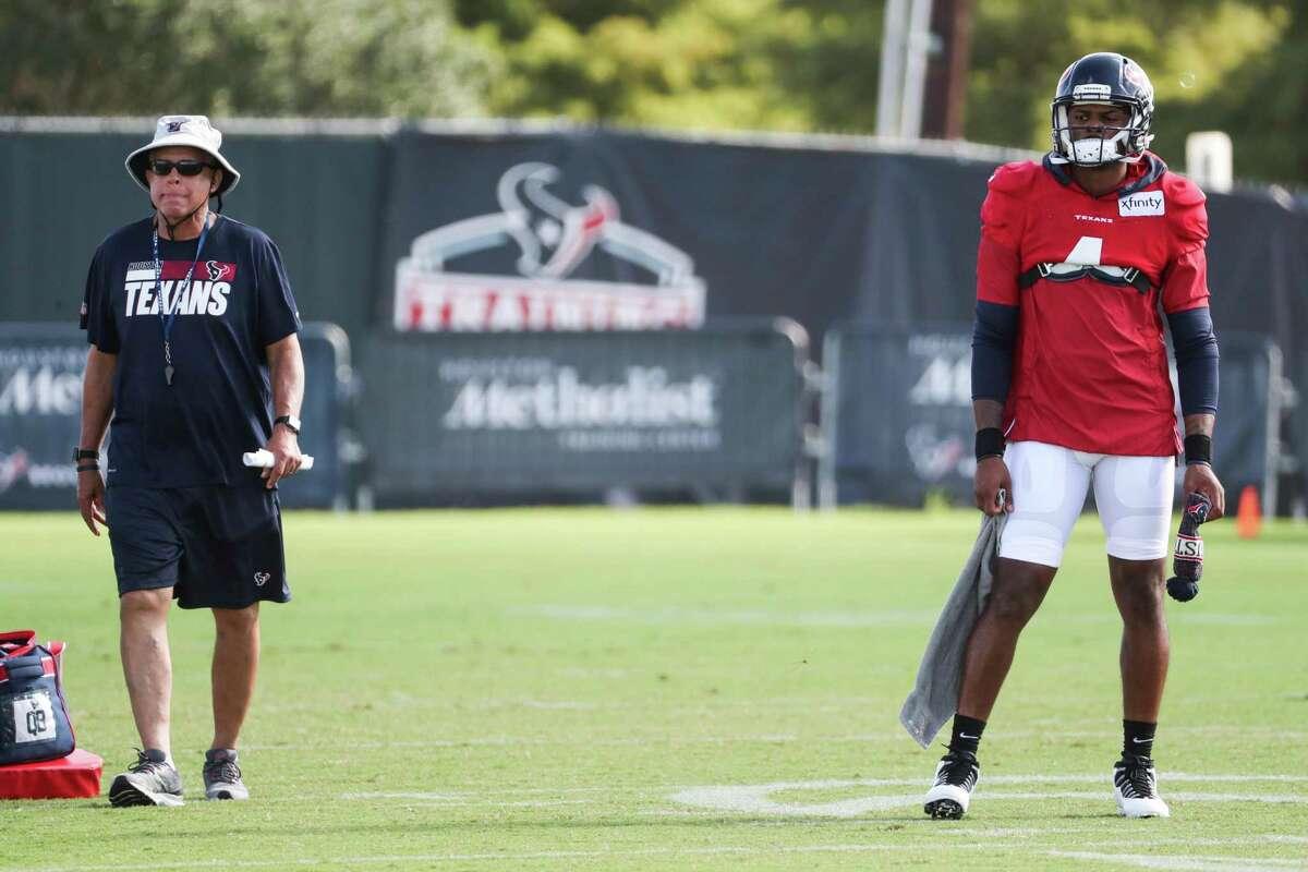 Houston Texans head coach David Culley walks past quarterback Deshaun Watson (4) during an NFL training camp football practice Monday, Aug. 9, 2021, in Houston.