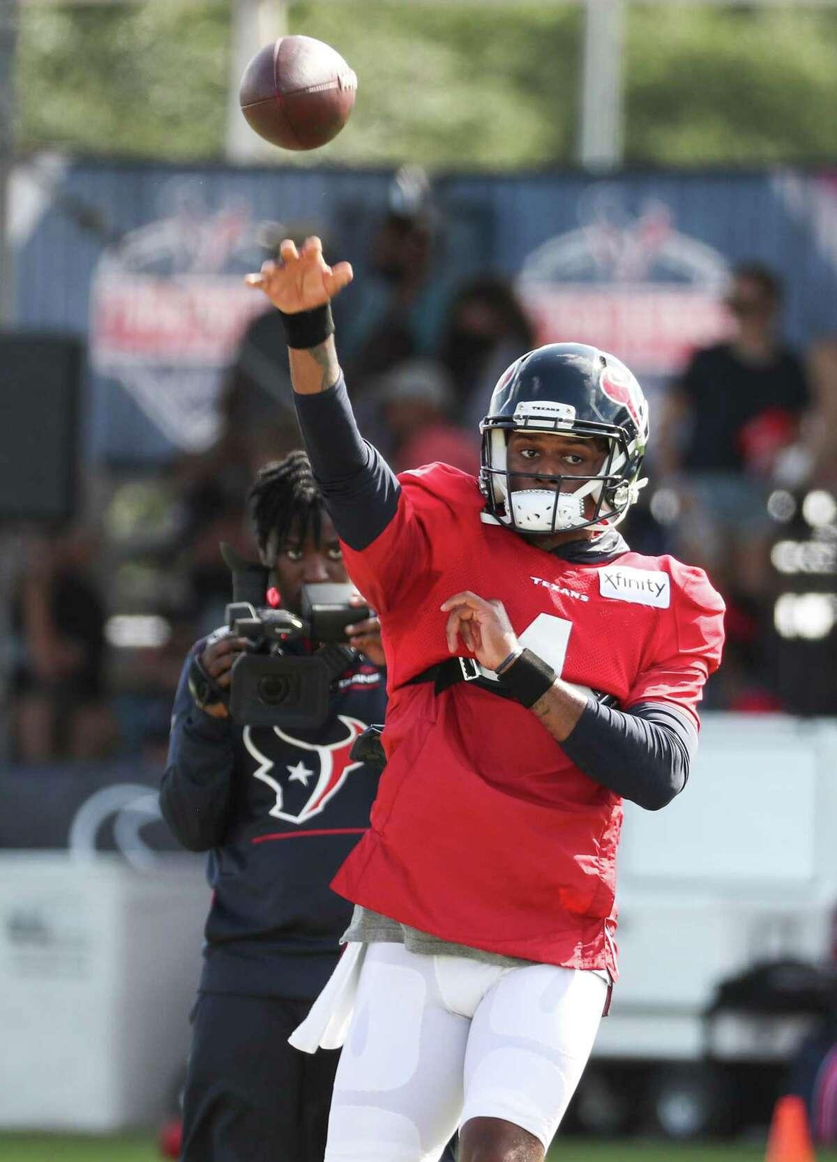 Houston Texans quarterback Deshaun Watson (4) throws a pass during an NFL training camp football practice Monday, Aug. 9, 2021, in Houston.