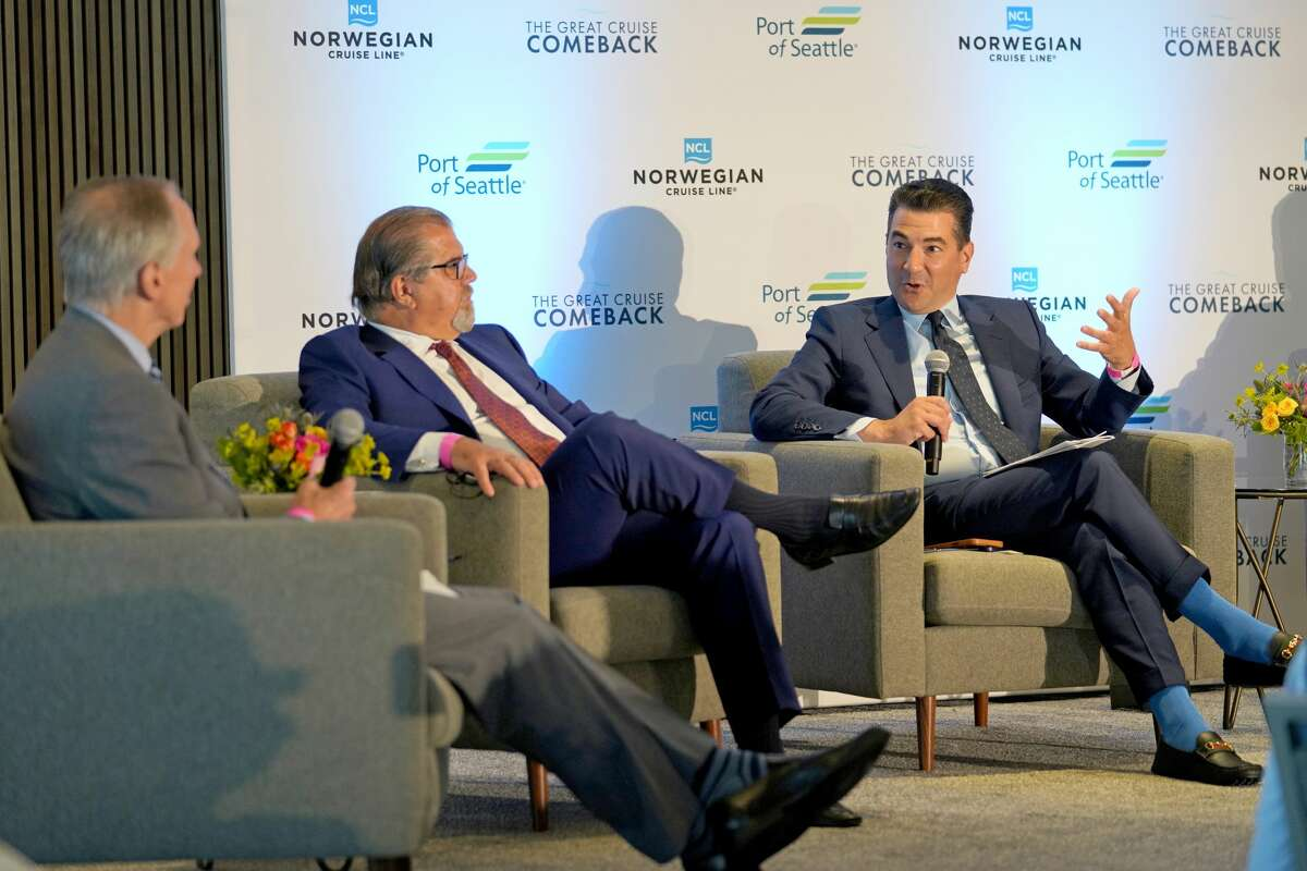 SEATTLE, WASHINGTON - AUGUST 06: (L-R) President and CEO of Visit Seattle Tom Norwalk, President and CEO of Norwegian Cruise Line Holdings Ltd. Frank Del Rio, and Former Commissioner of the U.S. Food and Drug Administration and Chairman of the SailSAFE™ Global Health and Wellness Council Dr. Scott Gottlieb speak onstage at the Norwegian Cruise Line's Great Cruise Comeback Press Panel on August 06, 2021 in Seattle, Washington. (Photo by Suzi Pratt/Getty Images for Norwegian Cruise Line)