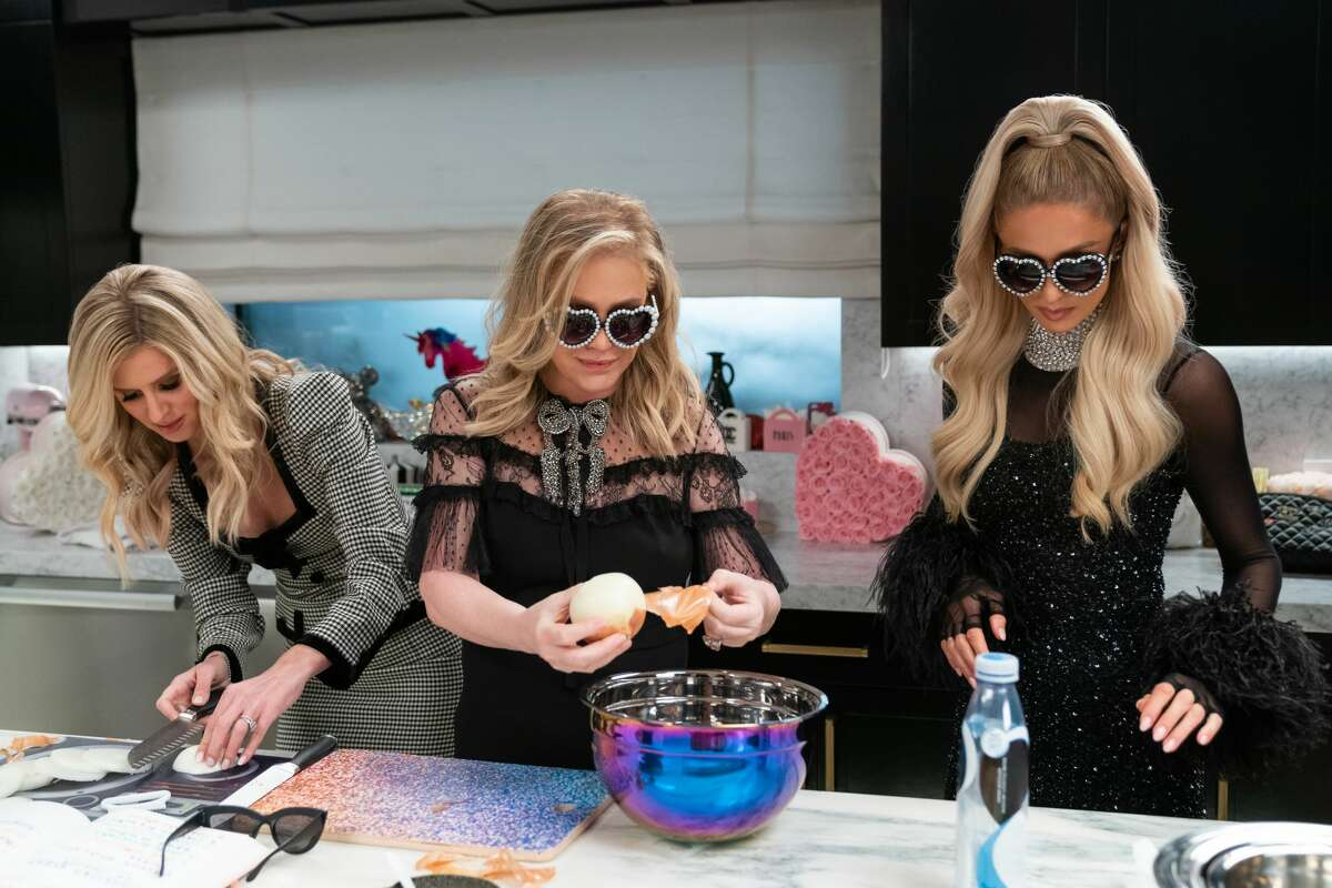 """Paris Hilton cooks dinner with Nicky Hilton Rothschild, left, and Kathy Hilton, middle, in the new Netflix show """"Cooking With Paris."""""""