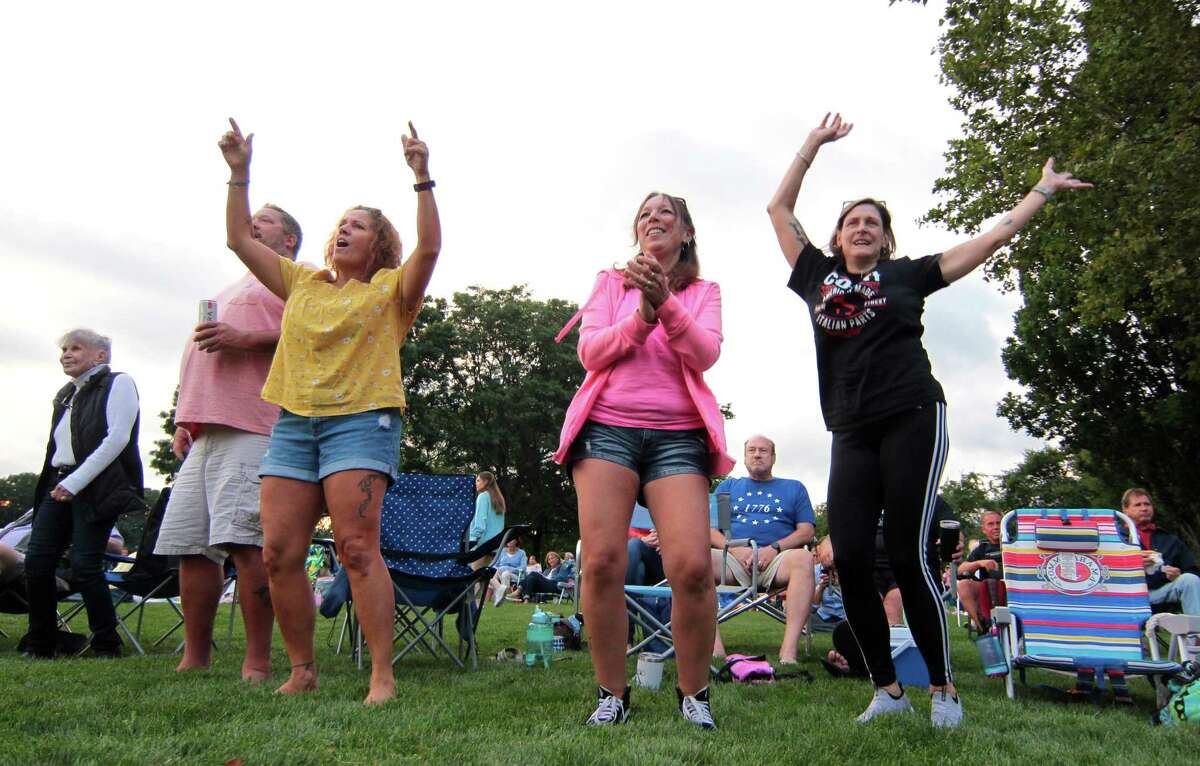 Area residents dance to hit songs from the 70's and 80's performed by the LP's during the Department of Parks and Recreation's Wednesday Night Concert Series at Roger Sherman Baldwin Park in Greenwich, Conn., on Wednesday August 4, 2021. The series continues with this lineup: Cynthia Sayer & Her Joyride Band will play jazz on Aug. 11: and Billy and the Showmen will perform R & B songs on Aug. 18. All concerts start at 7:15 p.m., and the rain date for each show is the next day. No pets and no grills allowed.