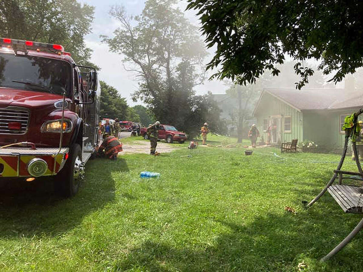 Smoke lingered in the air Sunday as a single-family home burned in Holiday Shores.