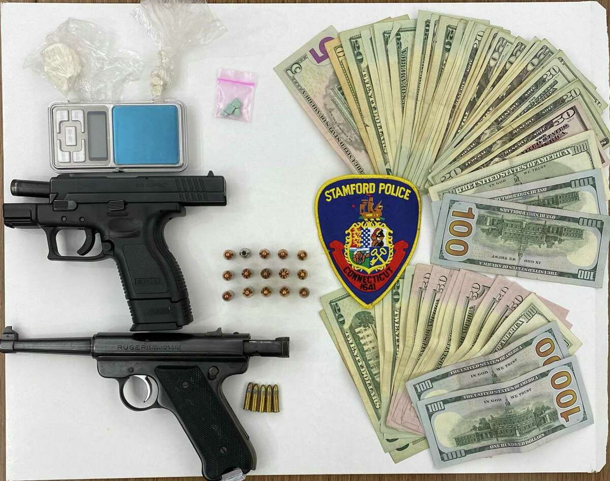 Stamford police said they seized two guns, illegal high-capacity magazines, crack cocaine, ecstasy and more than $2,000 in cash during the arrest.