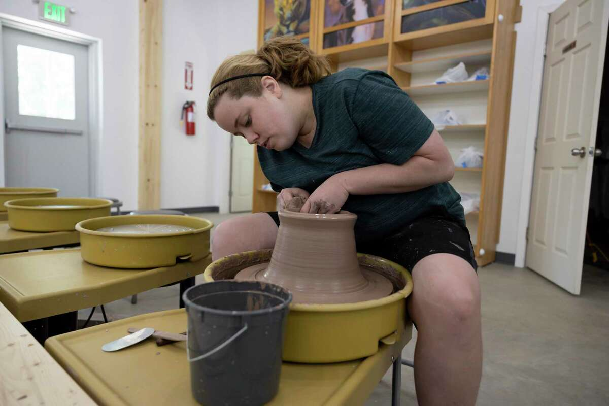 Kinsey Lane throws clay at Woodland Lane Ceramics, Saturday, Aug. 7, 2021, in Magnolia. The studio offers a variety of packages for all level of skills and ages through a 5-week and 12-week program.