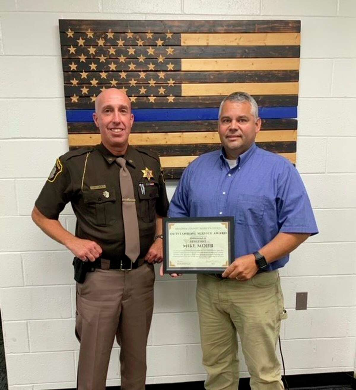 Sgt. Mike Mohr (right), of the Mecosta County Sheriff'sOffice,received the Outstanding Service Award from Sheriff Brian Miller (left). (Photo courtesy of the Mecosta County Sheriff's department)