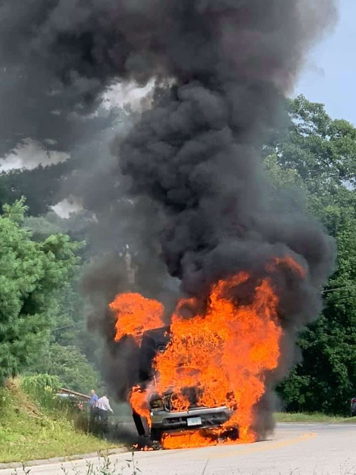 A van catches fire in Morris on the way to a wedding reception at South Farms.