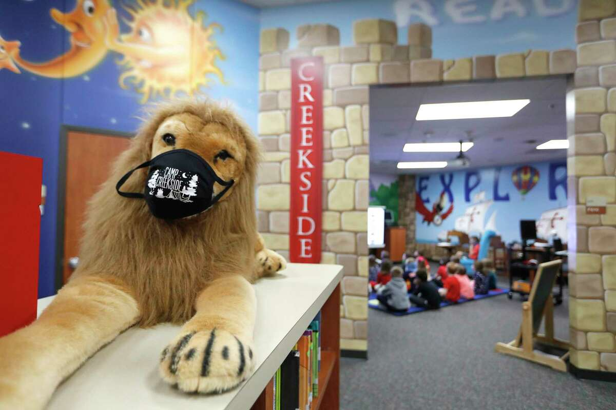 A masked stuffed lion in the library at Creekside Forest Elementary in Tomball ISD, in Spring, Wednesday, Feb. 3, 2021. Creekside Forest Elementary earned the number two spot for best elementary school in the Houston region in Children at Risk's annual rankings. Tomball ISD was rated as the best school district in the region and fifth best in the state.