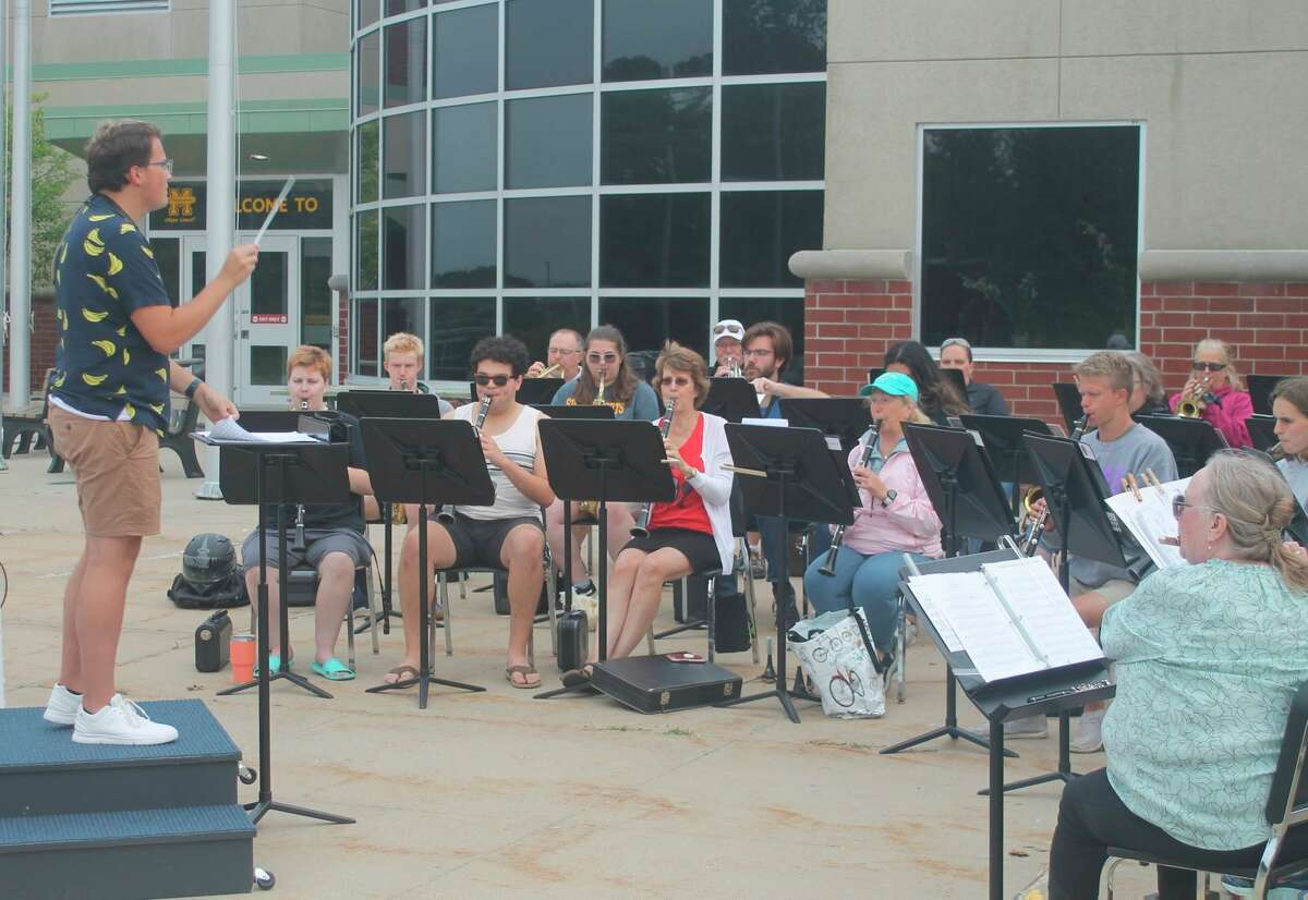 In this file photo, the Manistee Community Band rehearses outside of the Manistee Middle High School building. (File photo)