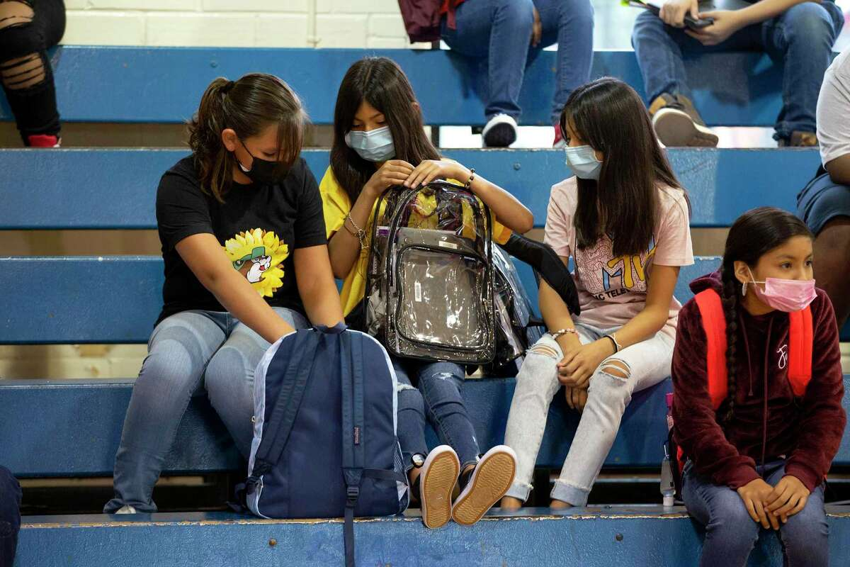 Friends and seventh-graders Corina Garza, from left, Audrianna Esqueda and Aubrianna Esqueda talk before the start of the first day of school at Hot Wells Middle School on Monday.