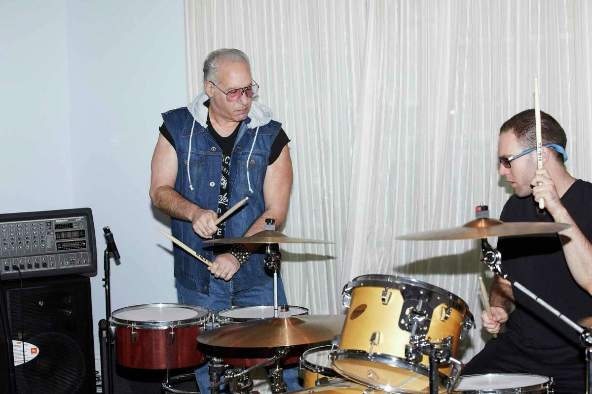 """Andrew Dice Clay and his son Max in the living room-turned-rehearsal-space at Clay's home in Los Angeles in 2019. Clay, who has received accolades for his portrayal of a doting and melancholy father in """"A Star Is Born,"""" says Dice, the outrageously offensive guy he brings to life in his comedy act, is nothing more than an alter ego he assumes to get laughs."""