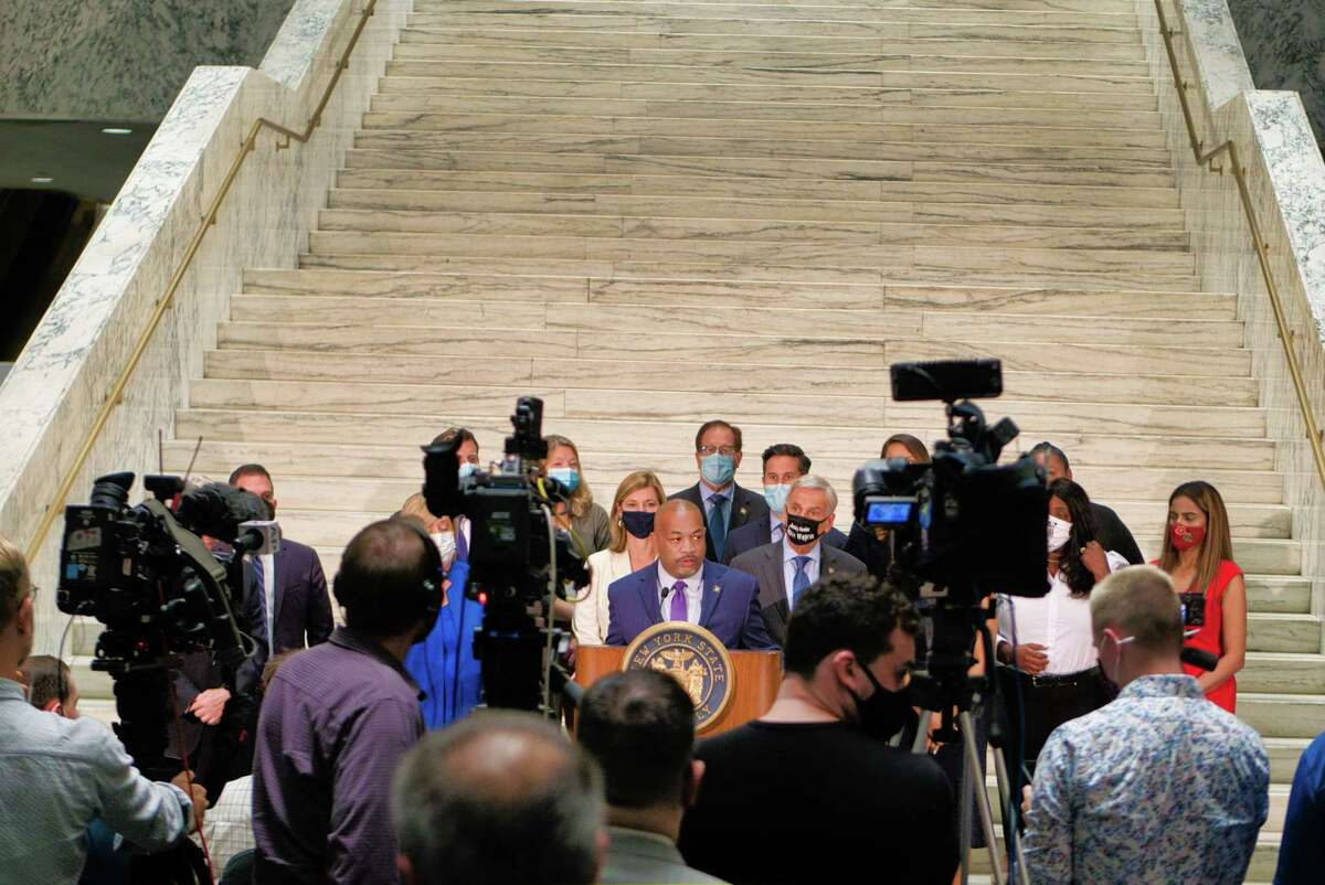 Assembly Speaker Carl Heastie, center, and members of the Assembly Judiciary Committee take part in a press conference following a committee meeting on Monday, Aug. 9, 2021, in Albany, N.Y. The committee is investigating Governor Andrew Cuomo.