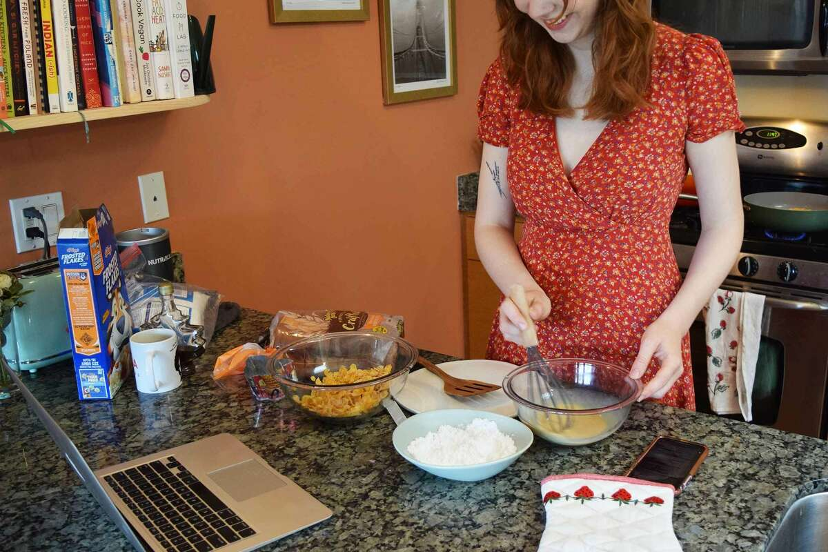 Whisking the eggs for Paris Hilton's frosted flakes French toast.