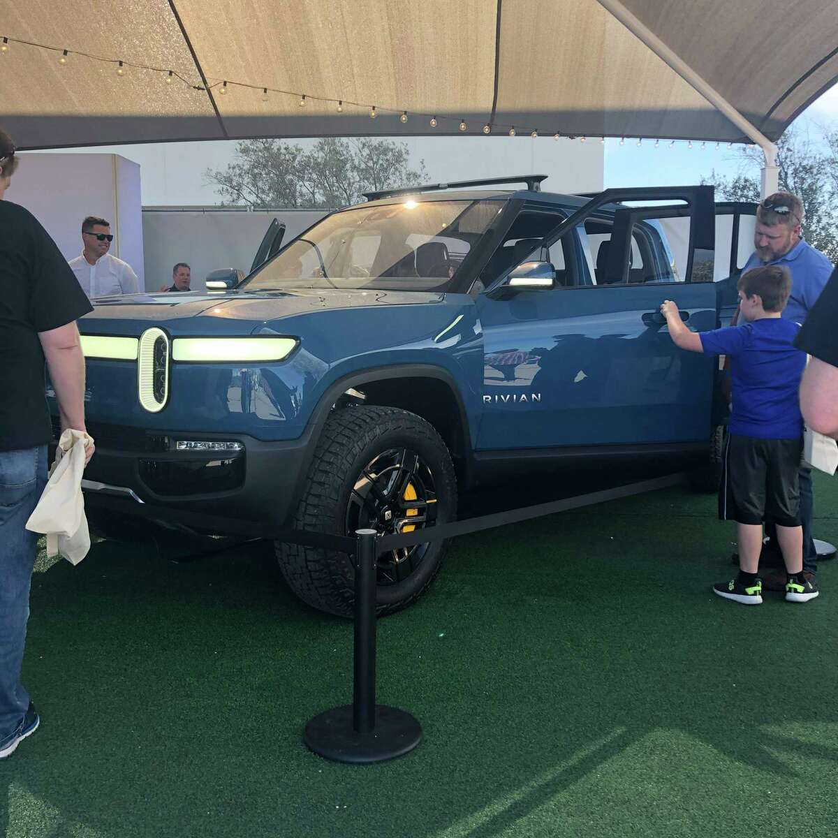 """A new electric vehicle from Rivian, which is producing a pick-up and a SUV, on display at """"Full Throttle LIVE,"""" an electric vehicle event in Austin, Texas."""