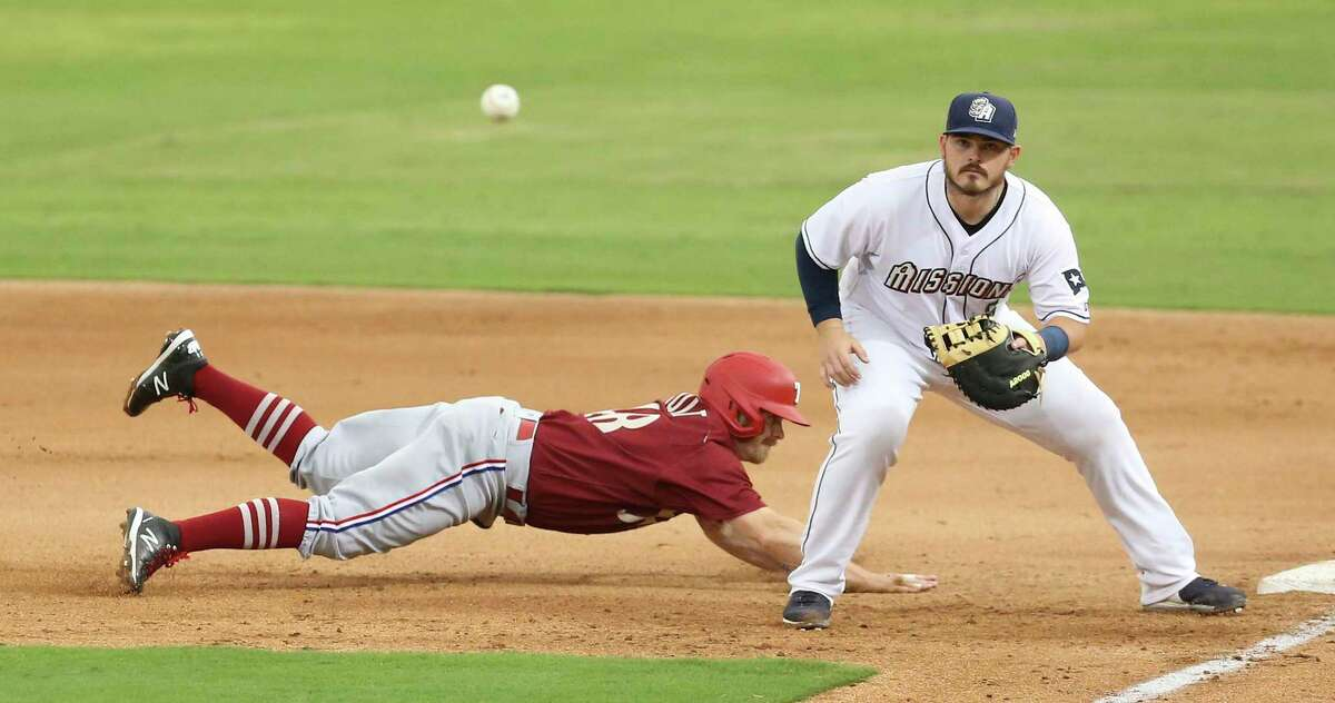The Missions' Kyle Overstreet, right, awaits a throw to first base as the Frisco RoughRiders' Brock Holt dives back to the bag at Wolff Stadium on Tuesday, May 18, 2021.