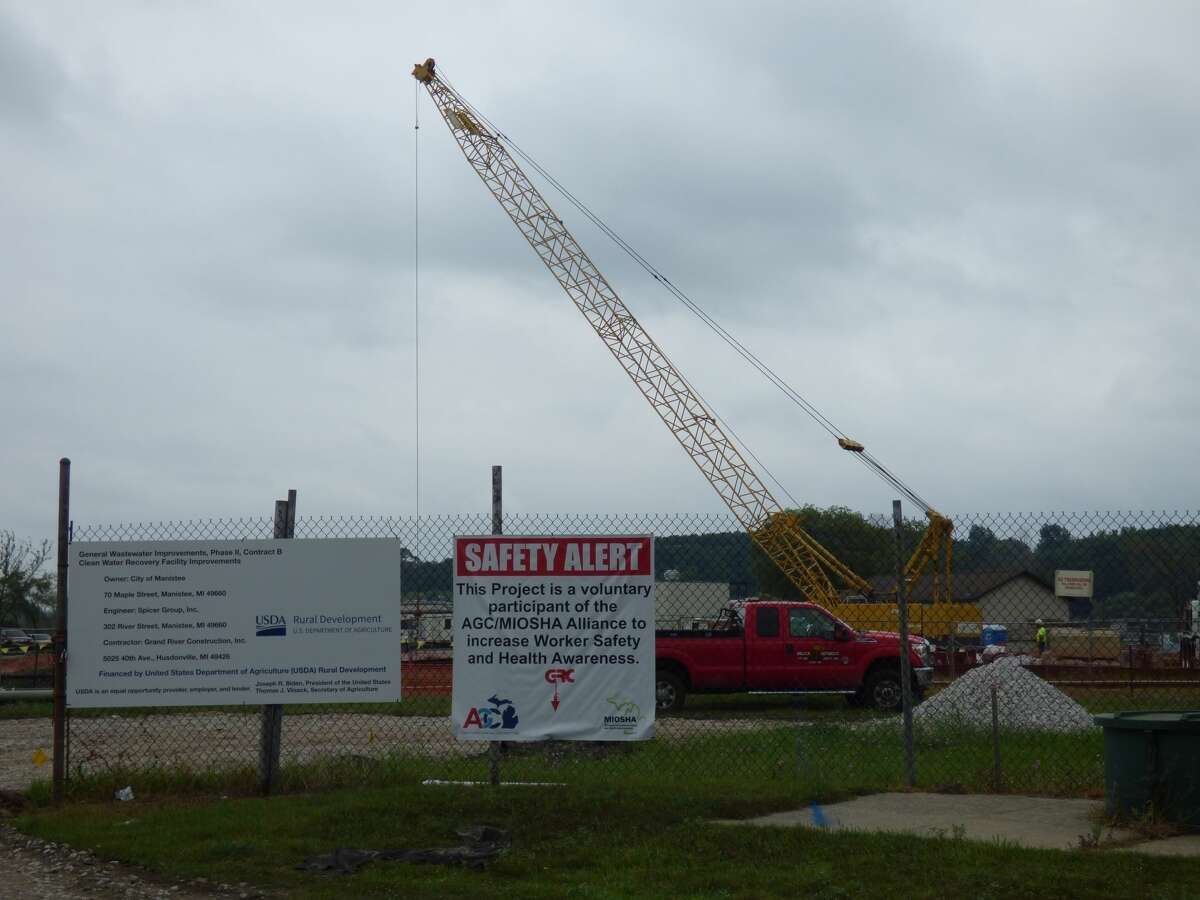Construction of a wastewater facility in Manistee continued in the rain Aug. 9.