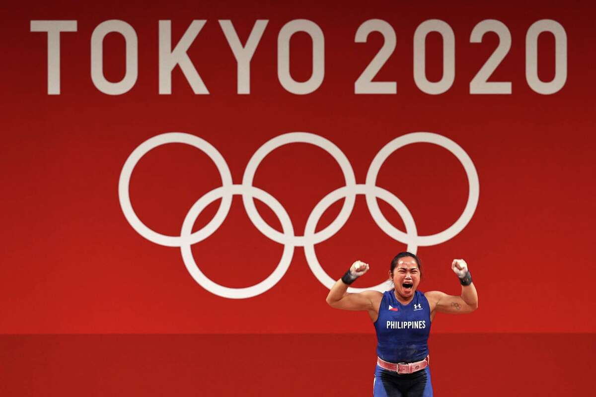 Weightlifter Hidilyn Diaz of Team Philippines celebrates while competing at the Tokyo 2020 Olympic Games on July 26.
