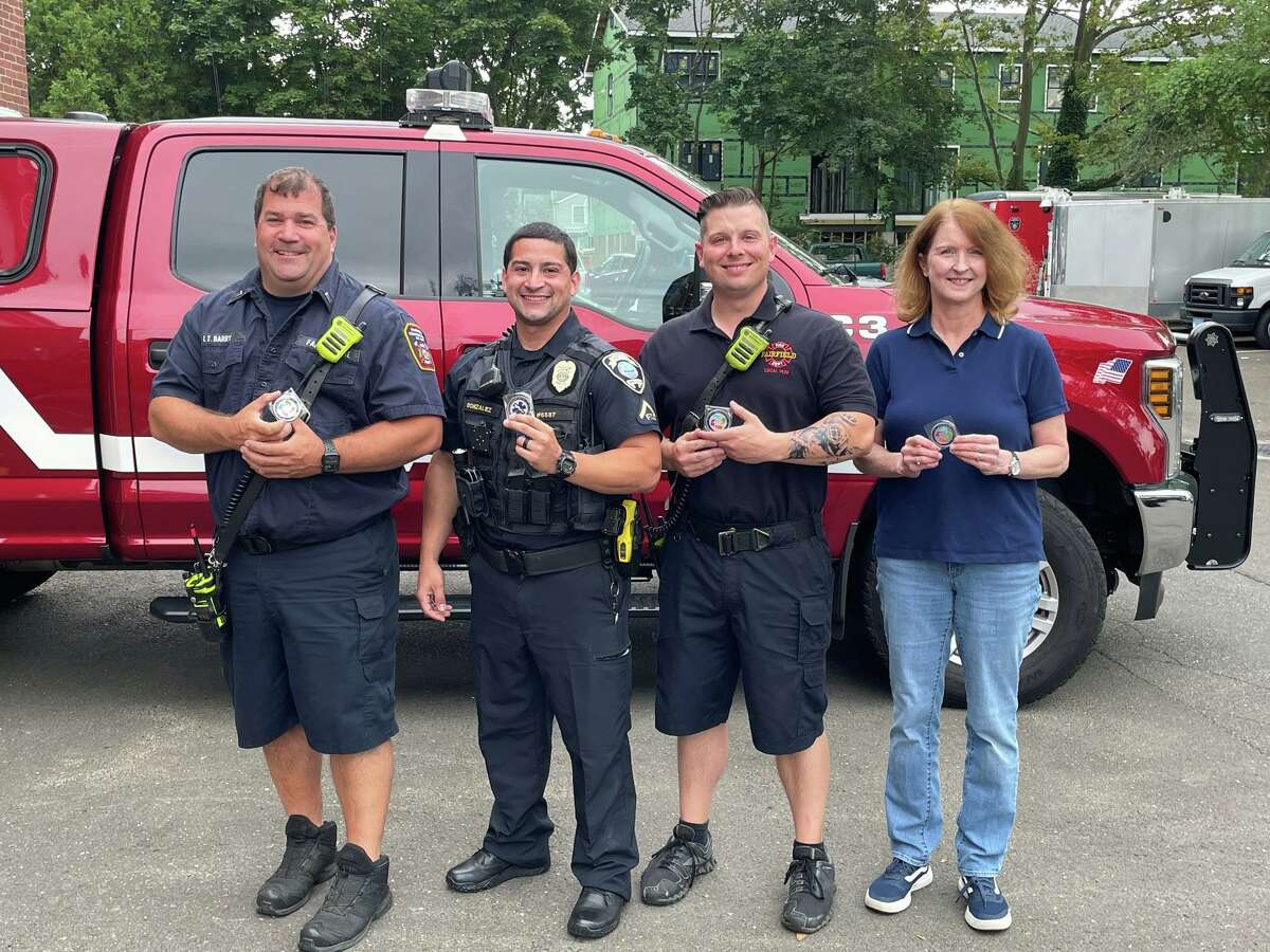 Pictured from left to right are Lt. Patrick Barry, officer Felix Gonzalez, firefighter Justin Crawford and telecommunicator Lynn Erazmus.