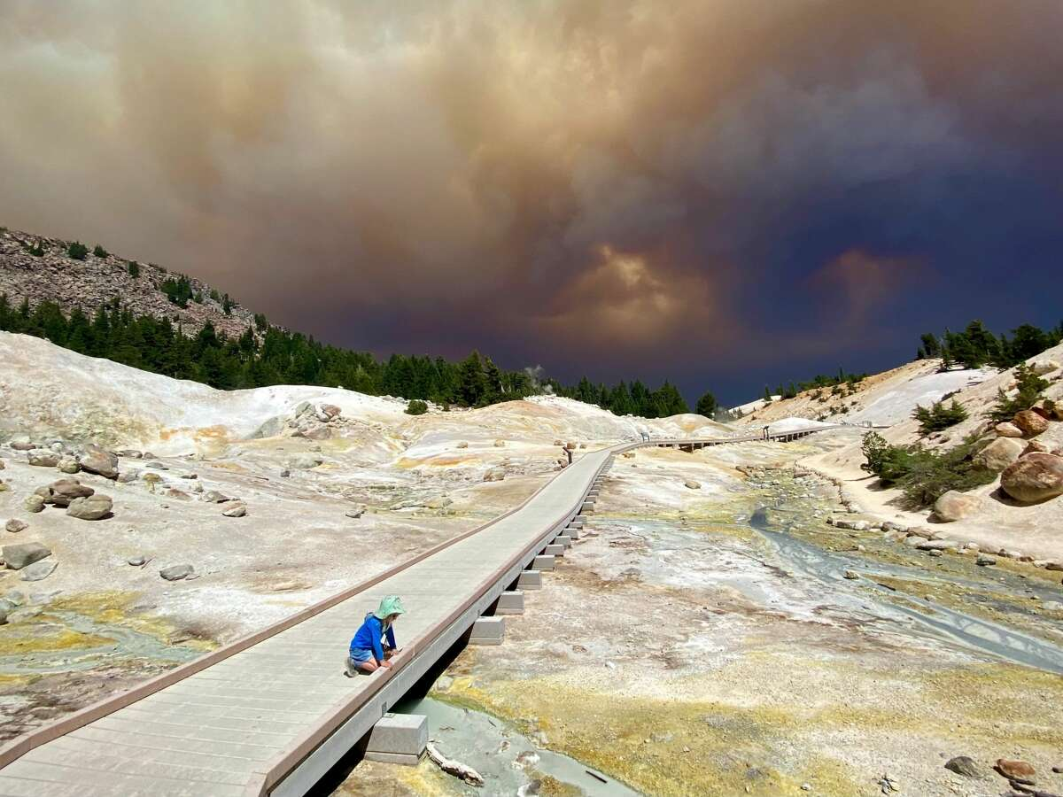 A 4-year-old girl gets a final glimpse of Bumpass Hell before the Dixie Fire enters Lassen Volcanic National Park.