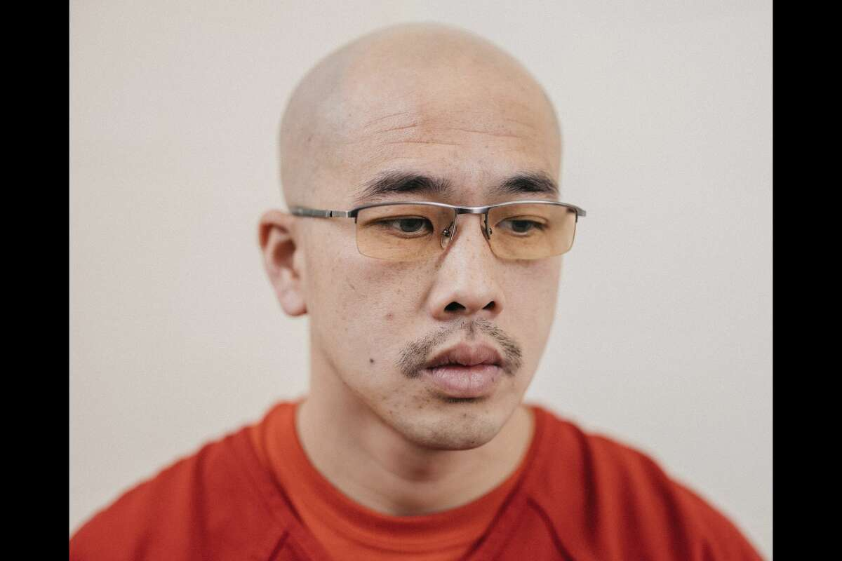 Phi Pham poses for a portrait in an ICE detention facility in Aurora, Colorado on August 2, 2021.