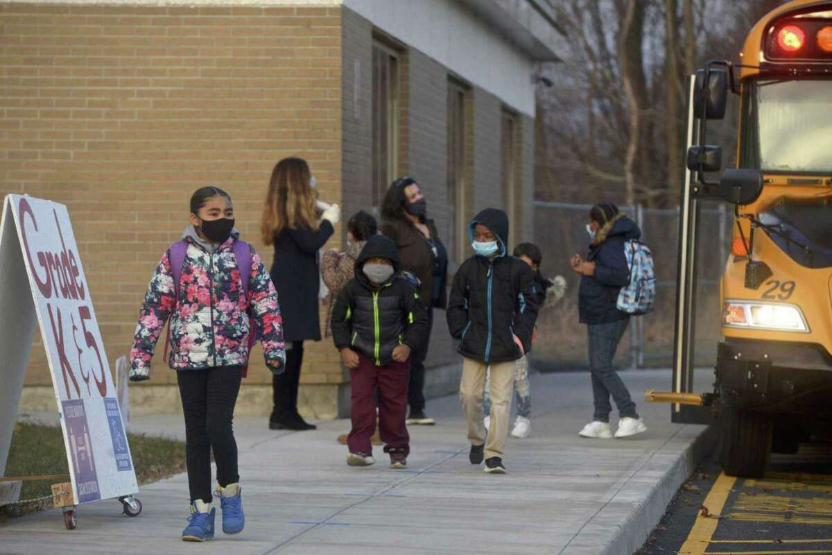 Students in the nearby city of Danbury head into school wearing masks in January 2021.