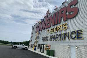 A car drives north into Canada past a souvenir shop on August 9, 2021. This is the first day many American visitors have been allowed across the border. (Rebekah F. Ward/Times Union)