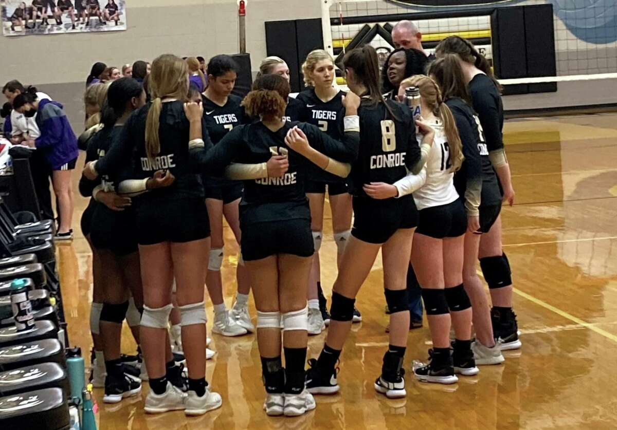 Conroe volleyball coach Charvette Brown speaks to her team in between sets Monday, August 9, 2021 in a match against Lufkin at Porter Gymnasium