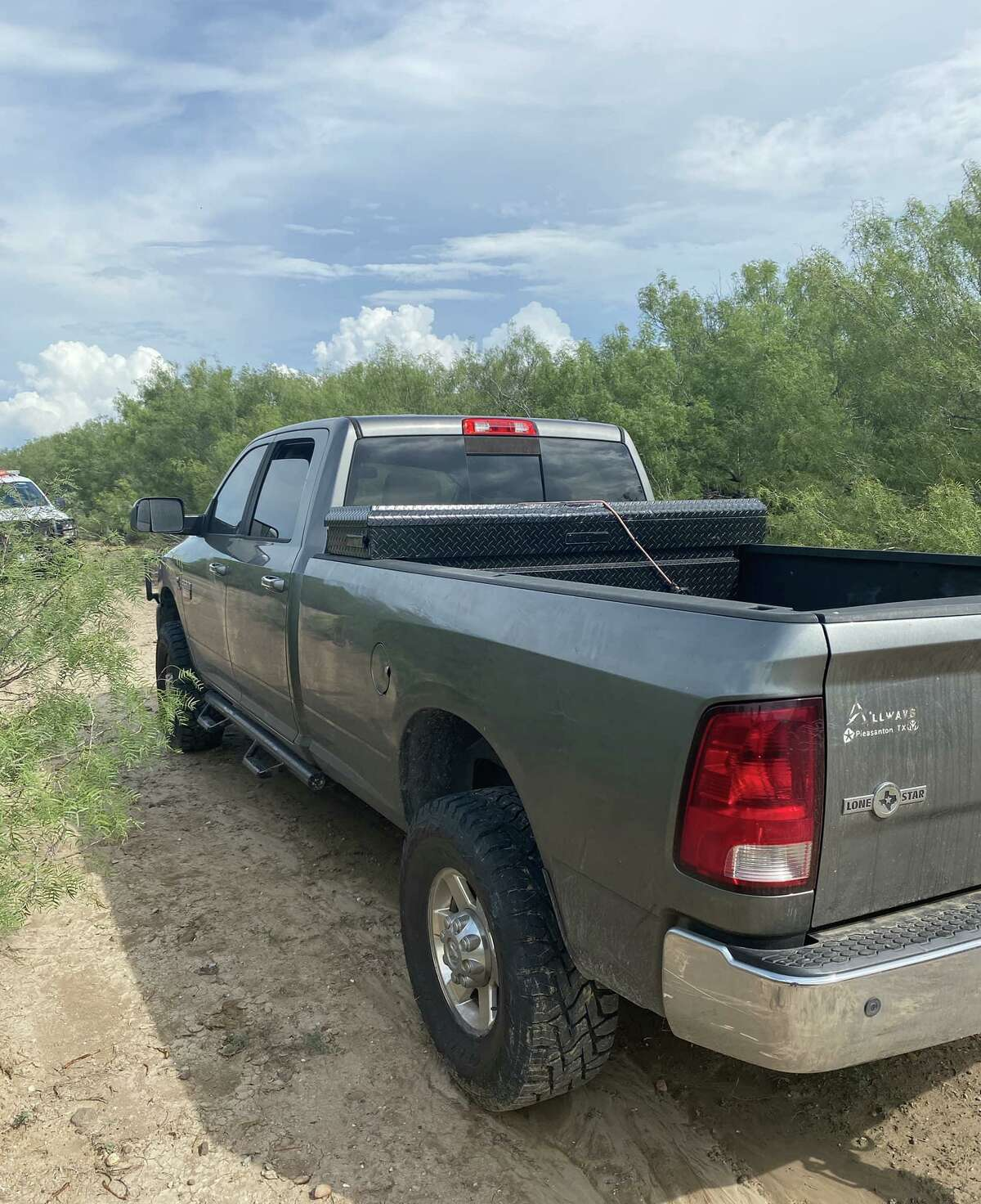 A truck reported stolen out of San Antonio was discovered inside a ranch by Freer agents after driving through a fence.