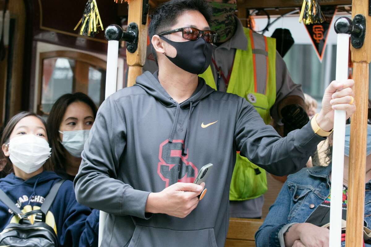 Riders on the San Francisco cable car wear face masks in San Francisco on Aug. 5, 2021.