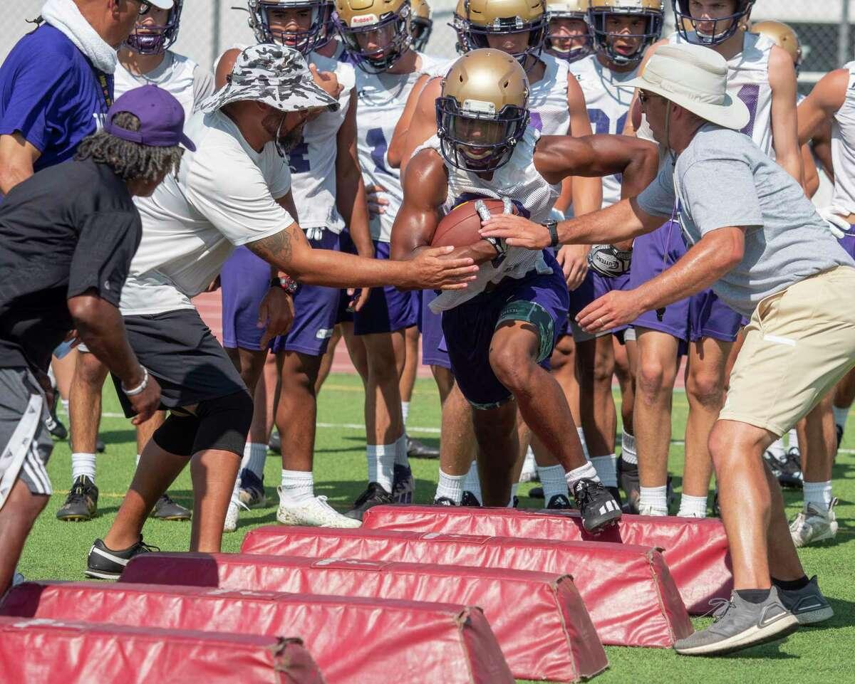 Midland High players run drills 08/09/2021 during the afternoon practice at Memorial Stadium. Tim Fischer/Reporter-Telegram