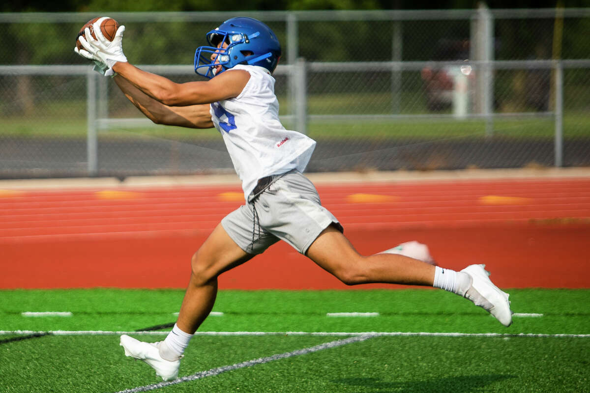 Midland's Jalen Brown catches a pass during the Chemics' first practice of the year Monday, Aug. 9, 2021 at Midland High School. (Katy Kildee/kkildee@mdn.net)