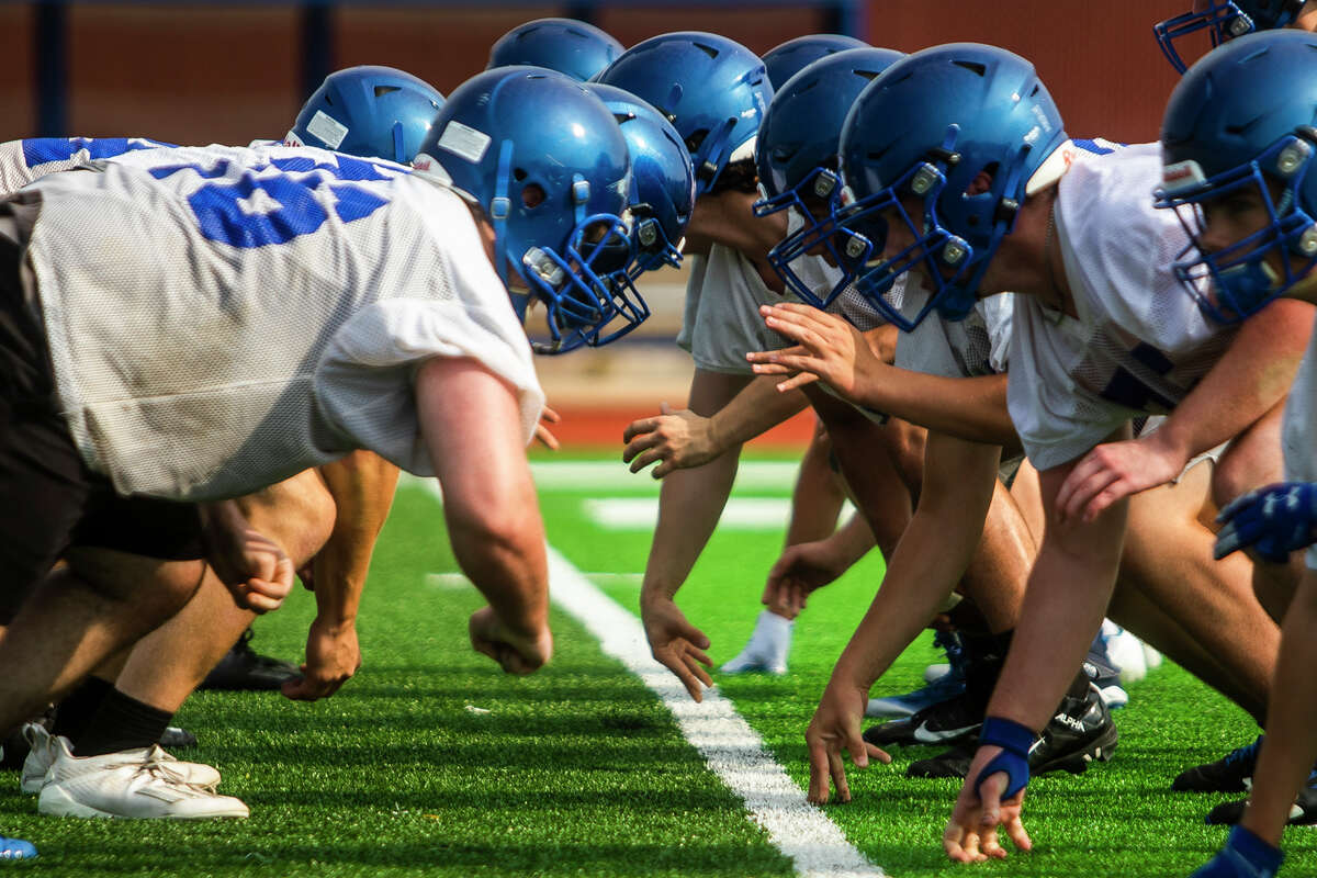The Chemics of Midland High holds their first football practice of the year Monday, Aug. 9, 2021 at Midland High School. (Katy Kildee/kkildee@mdn.net)