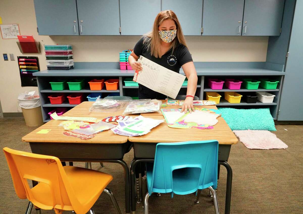 Vanessa Dino, a second grade math and science teacher, prepares her classroom at Reynolds Elementary School, 3975 Gladeridge Dr., Monday, Aug. 9, 2021 in Houston. Spring ISD students start classes on Aug. 11. Below: Fourth grade teachers Abigail Lawson, bilingual math and science, left, and Valerie Angel, math and science, right, participate in online training at Reynolds Elementary School, 3975 Gladeridge Dr., Monday, Aug. 9, 2021 in Houston. Spring ISD students start classes on Aug. 11.