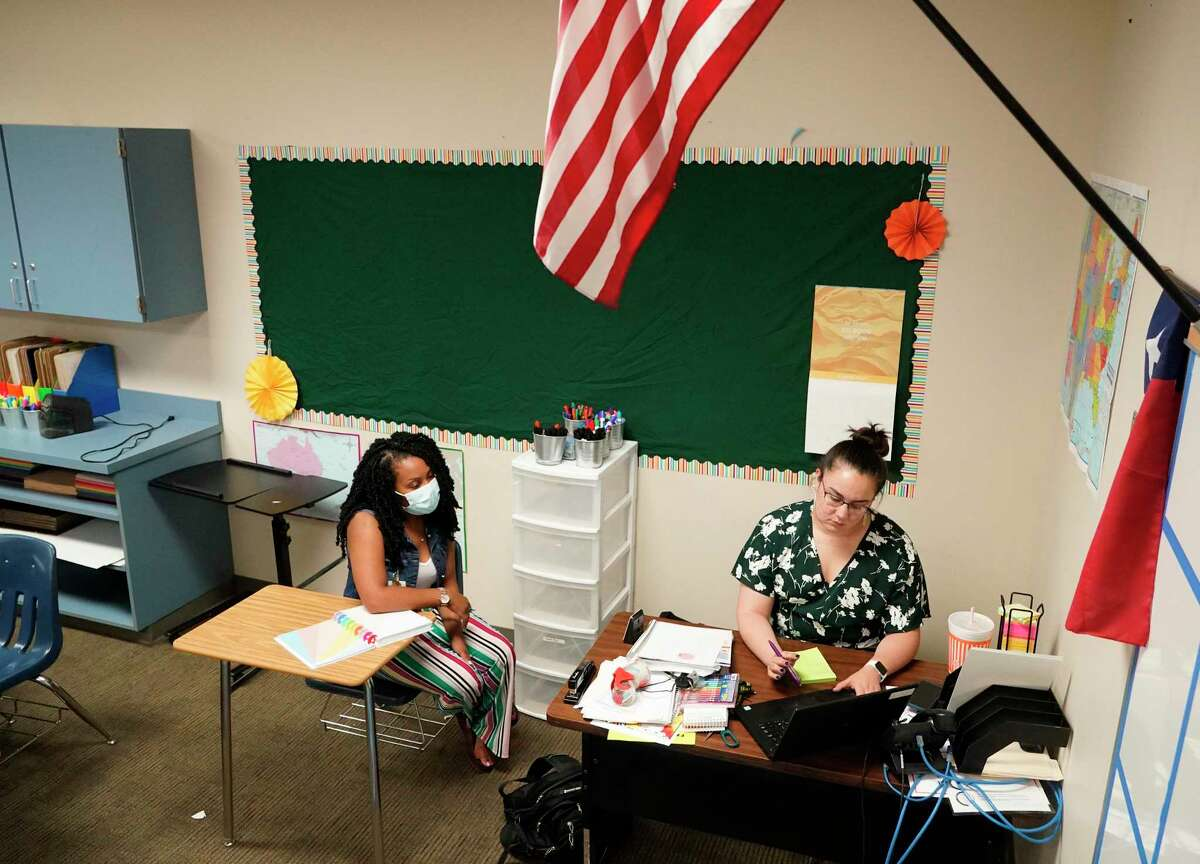 Fourth grade teachers Abigail Lawson, bilingual math and science, left, and Valerie Angel, math and science, right, participate in online training at Reynolds Elementary School, 3975 Gladeridge Dr., Monday, Aug. 9, 2021 in Houston. Spring ISD students start classes on Aug. 11.