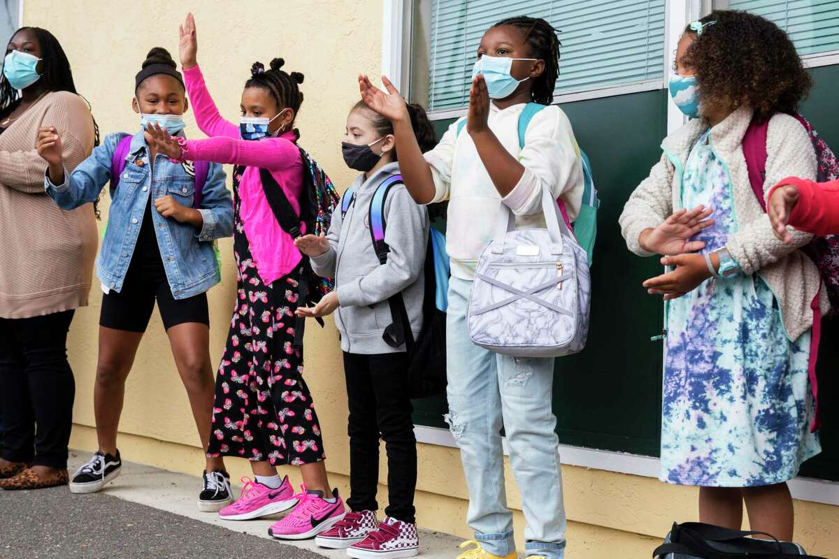 At Oakland Academy of Knowledge elementary school in Oakland, Calif. Monday, August 9, 2021. Oakland Unified School District students returned to the classroom with masks enforced for their first day of school.
