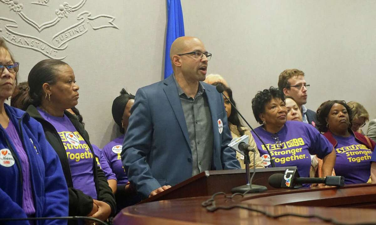 Rob Baril, president of SEIU 1199 New England, with nursing home workers who came to the state Capitol in Hartford, Conn. on Wednesday May 1, 2019.