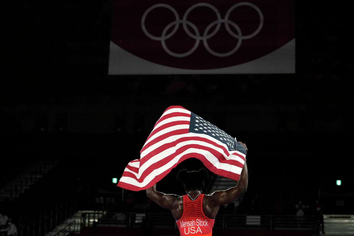 United States' Tamyra Mensah-Stock celebrates defeating Nigeria's Blessing Oborududu and winning the women's 68 kg freestyle wrestling final match at the 2020 Summer Olympics, Tuesday, Aug. 3, 2021, in Chiba, Japan.