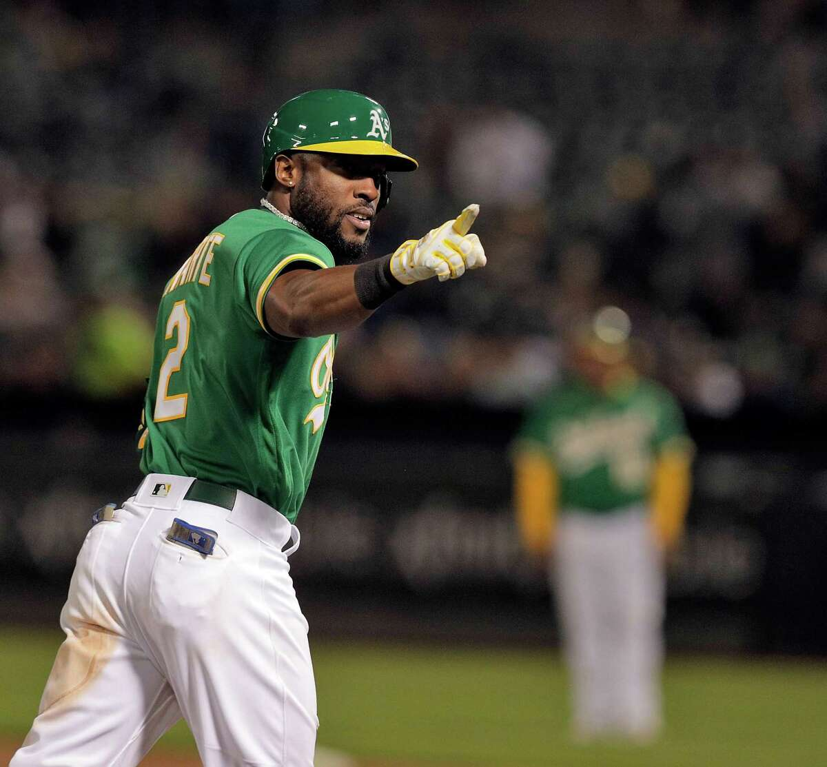 Starling Marte (2) points to the dugout after hitting a solo homerun in the fifth inning as the Oakland Athletics played the San Diego Padres at the Coliseum in Oakland, Calif., on Tuesday, August 3, 2021.