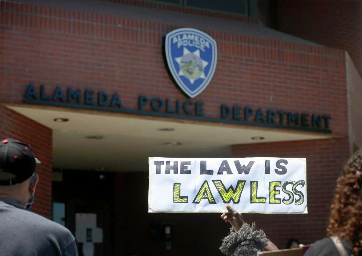 Demonstrators stage a sit-in at the Alameda Police Department to call attention to police brutality against people of color in Alameda, Calif. on Thursday, June 11, 2020.