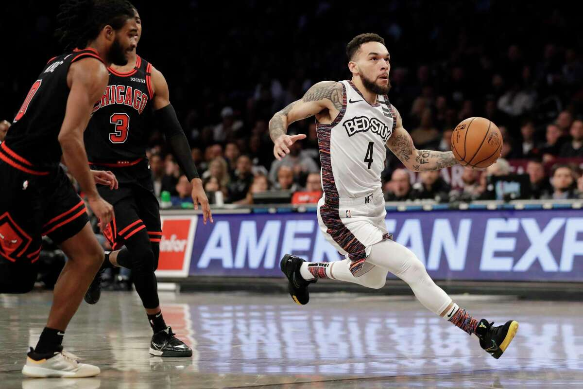Brooklyn Nets' Chris Chiozza (4) takes the ball to the basket during the second half of an NBA basketball game against the Chicago Bulls at the Barclays Center, Sunday, March 8, 2020, in New York. The Nets defeated the Bulls 110-107. (AP Photo/Seth Wenig)