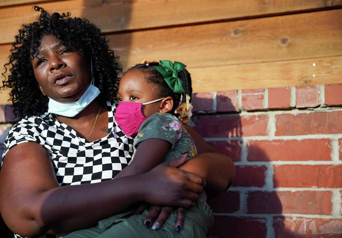 """LaTonya Payne talks about her son, Corinthian """"Mister"""" Giles, who passed away last month, while holding her three-year-old granddaughter Edyn Freeman on Monday, Aug. 9, 2021."""