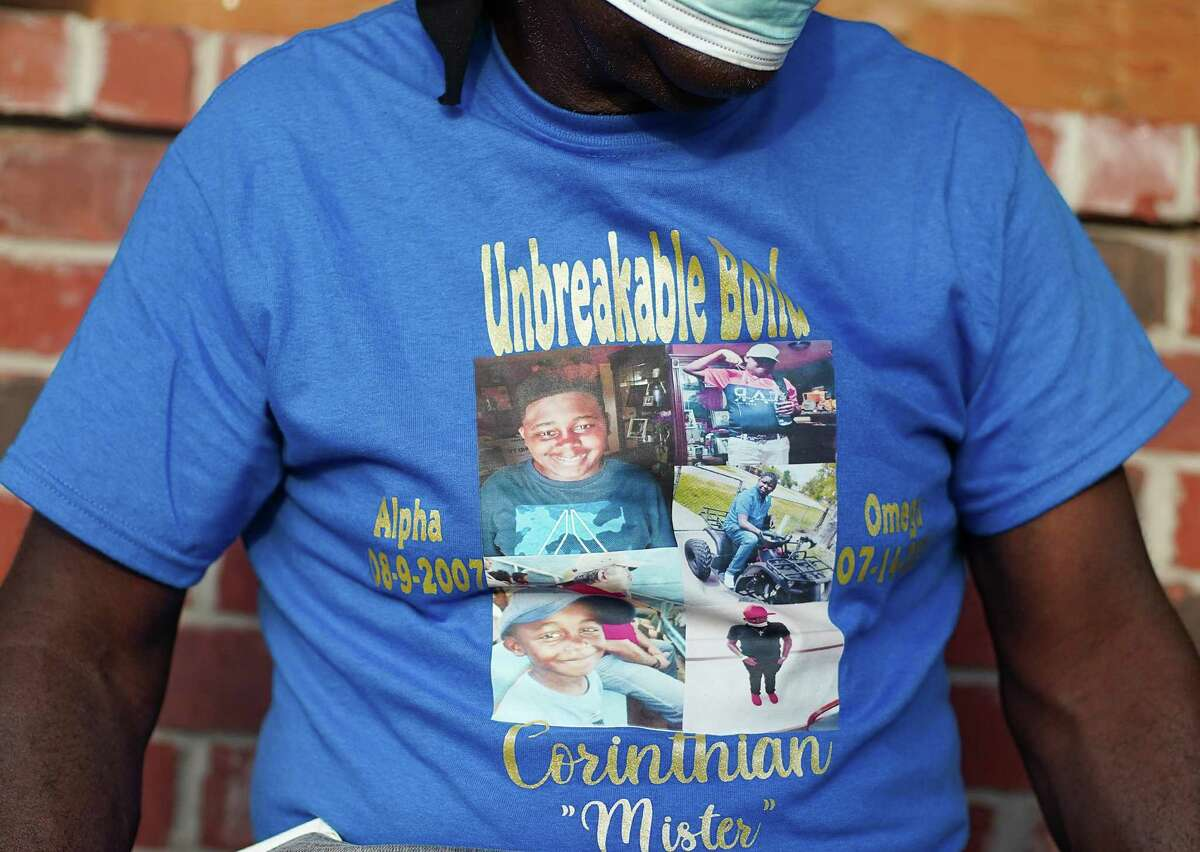 """LaTonya Payne's dad, Turner Lewis, wears a t-shirt in honor of Corinthian """"Mister"""" Giles, her son who passed away July 14 from cancer, before a dinner in honor of his birthday at Texas Roadhouse in Humble on Monday, Aug. 9, 2021."""