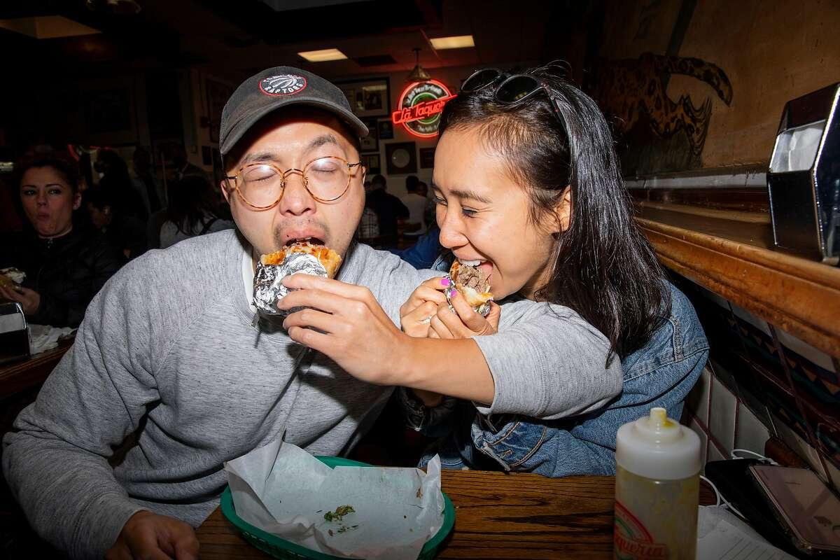 True romance? Phil Gene and Janice Kwan share a burrito at La Taqueria.