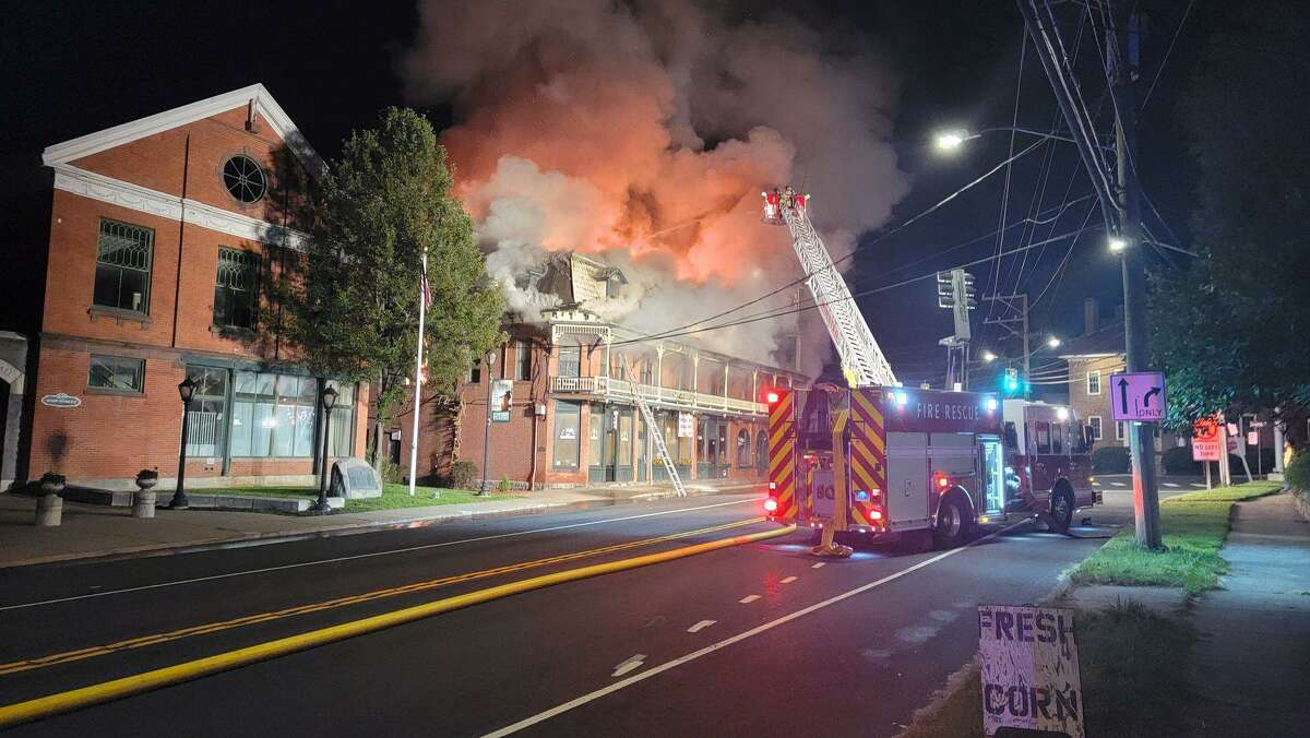 Fire crews battle three-alarm blaze at New Hartford House. The mixed occupancy building on Bridge Street caught fire during the early morning hours of Tuesday, officials said.
