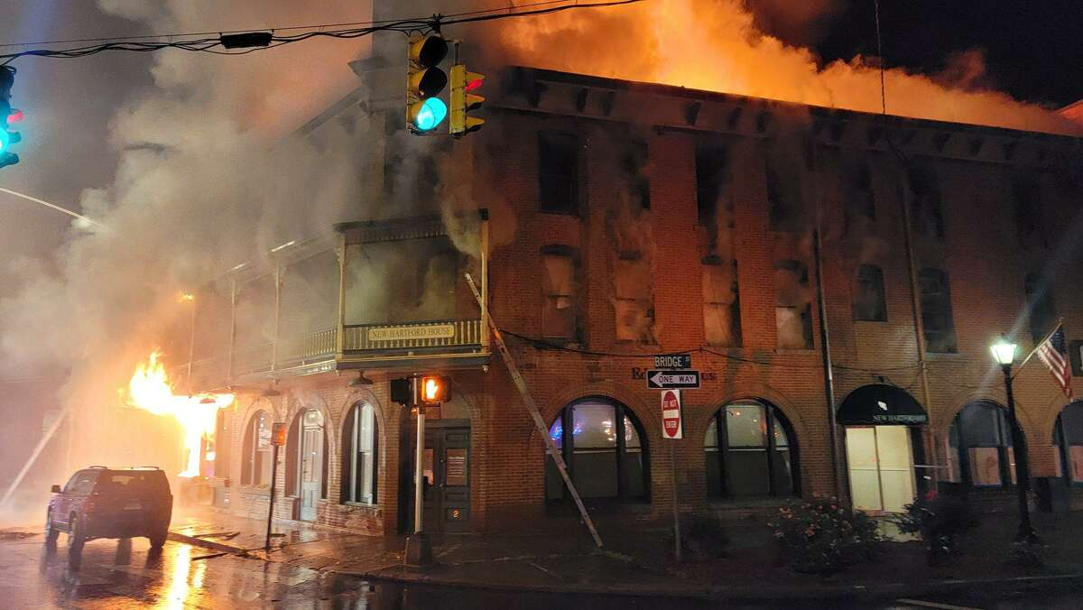 Fire crews battle three-alarm blaze at New Hartford House. The mixed occupancy building on Bridge Street caught fire during the early morning hours of Tuesday, officials said..