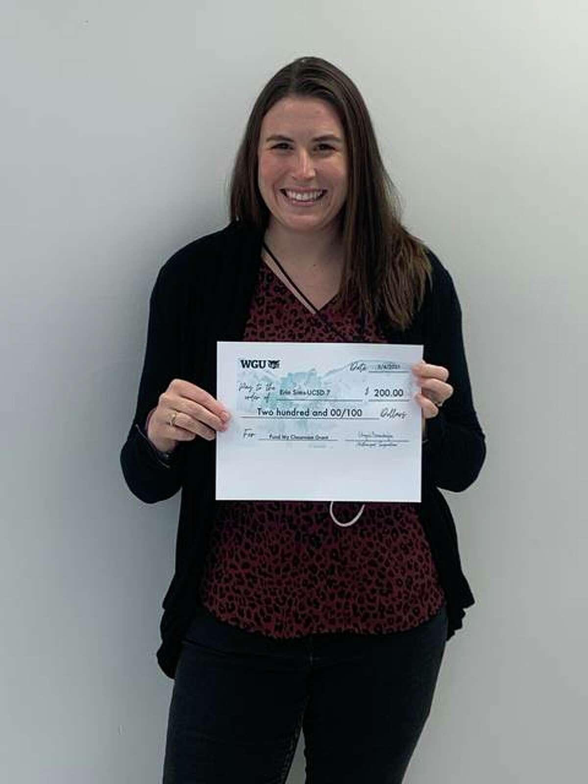 """Cassens Elementary School teacher Erin Sims with the Western Governors University's """"Fund My Classroom"""" grant she received in May."""