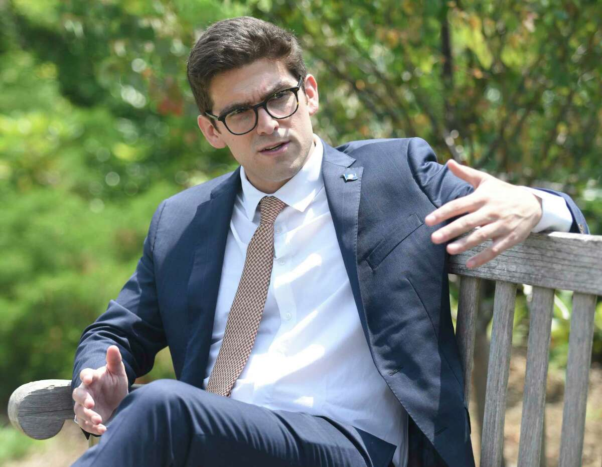 Ryan Fazio, a Republican candidate for the 36th District State Senate special election, chats at Greenwich Commons in Greenwich, Conn. Wednesday, July 28, 2021.